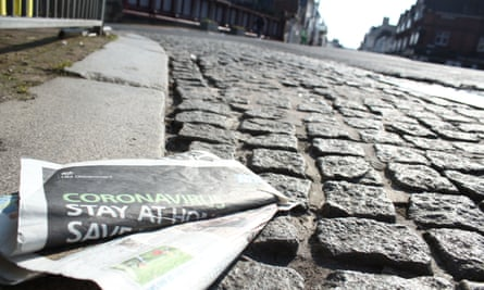 A discarded newspaper showing a government warning for people to stay at home