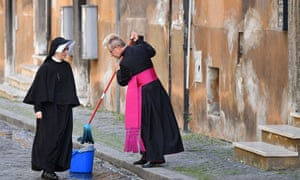 *** BESTPIX *** TOPSHOT-ITALY-HEALTH-VIRUS-POPE-MASSTOPSHOT - Bishop Josef Bart clean the street in front of at the Santo Spirito in Sassia church on Sunday before the arrival of Pope Francis for the Holy Mass on Divine Mercy with closed doors due to the social distancing rules.