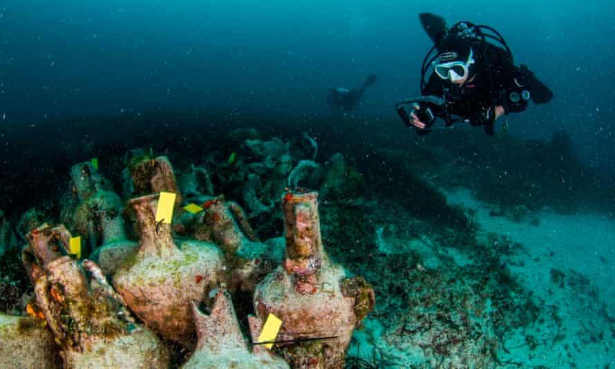 Divers viewing amphorae