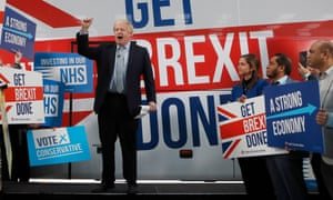 Boris Johnson by his campaign bus in Manchester.