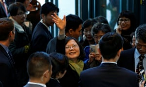 Tsai Ing-wen waves to supporters ahead of her departure from California bound for Taiwan.