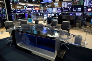 The CNBC Post 9 sits vacant on the floor of the New York Stock Exchange (NYSE), following traders testing positive for Coronavirus disease (COVID-19).