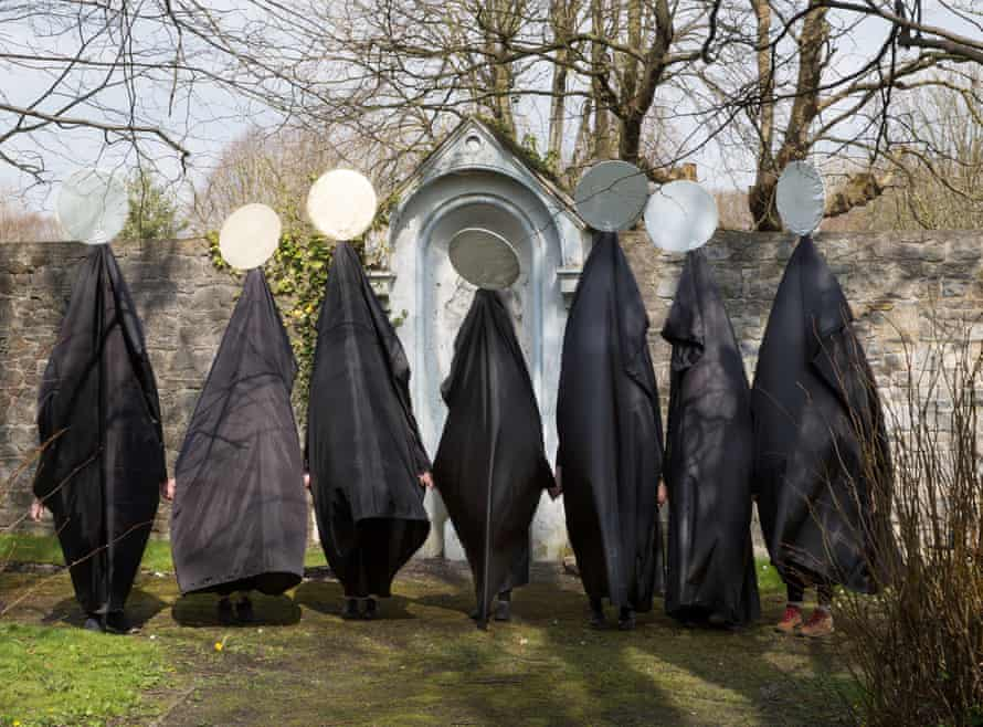 Giant figures called Cassandras wait to parade through Limerick in a silent appeal to residents to repeal the eighth amendment