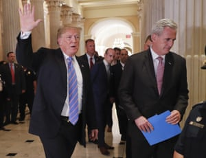 Stephen Miller is seen in the background, center, as Donald Trump and House majority leader Kevin McCarthy leave a meeting on Capitol Hill on Tuesday.