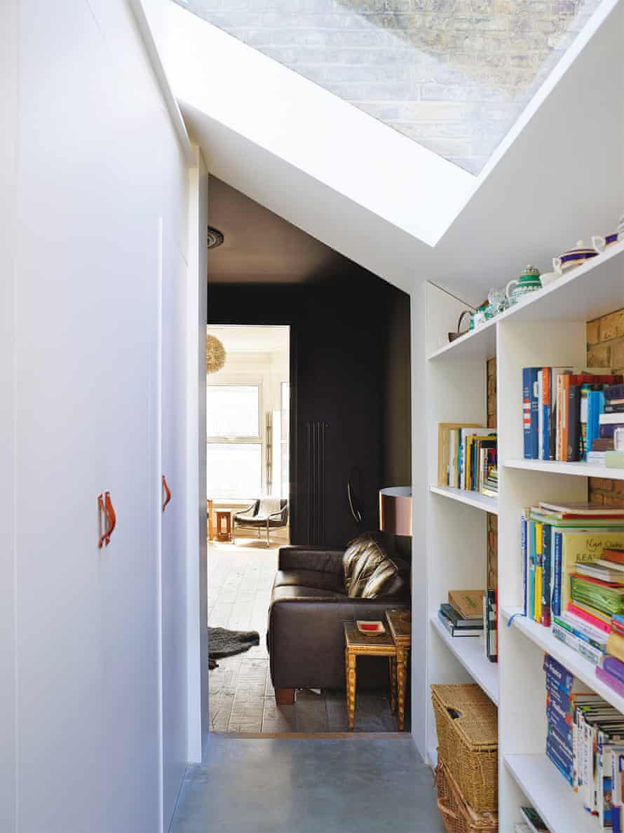 The view through to the book-lined TV snug; the leather cupboard handles are from etsy.com.