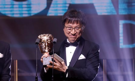 Nintendo's Shinya Takahashi accepts a BAFTA award for Super Mario Odyssey in 2018.