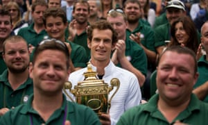 Andy Murray poses with the ground staff on Centre Court after his Wimbledon triumph.