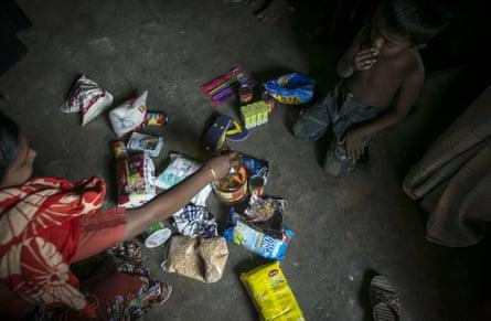 Rohingya refugees unpack relief supplies at the Leda Rohingya refugee camp in Chittagong, Bangladesh.