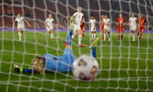 England's Ellen White scores their fourth goal from the penalty spot.