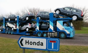 A transporter loaded with Honda cars leaves the Swindon factory