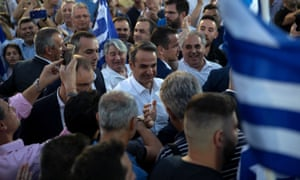 Kyriakos Mitsotakis is welcomed by supporters during a rally in Athens.