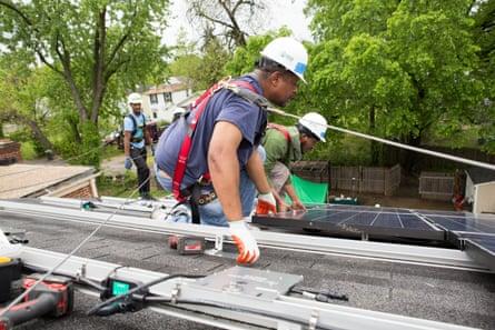 men solar panel roof install