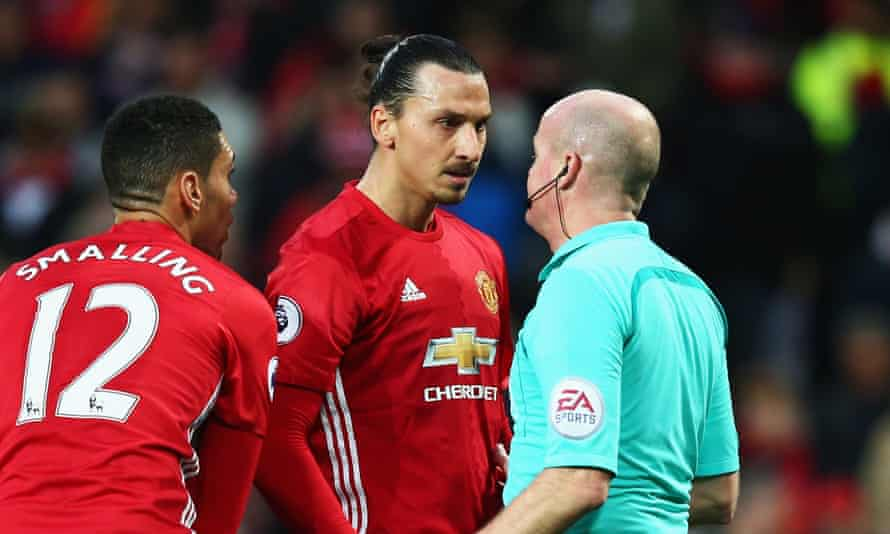 Zlatan Ibrahimovic of Manchester United speaks to the referee, Lee Mason, after his  goal is disallowed