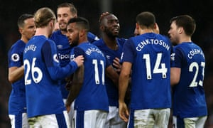 Everton players celebrate an own goal by Gaetan Bong of Brighton.