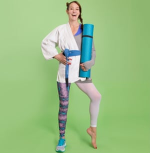 Zoe Williams holding yoga mat, wearing half a martial arts jacket, running legging and trainer, and yoga leggings