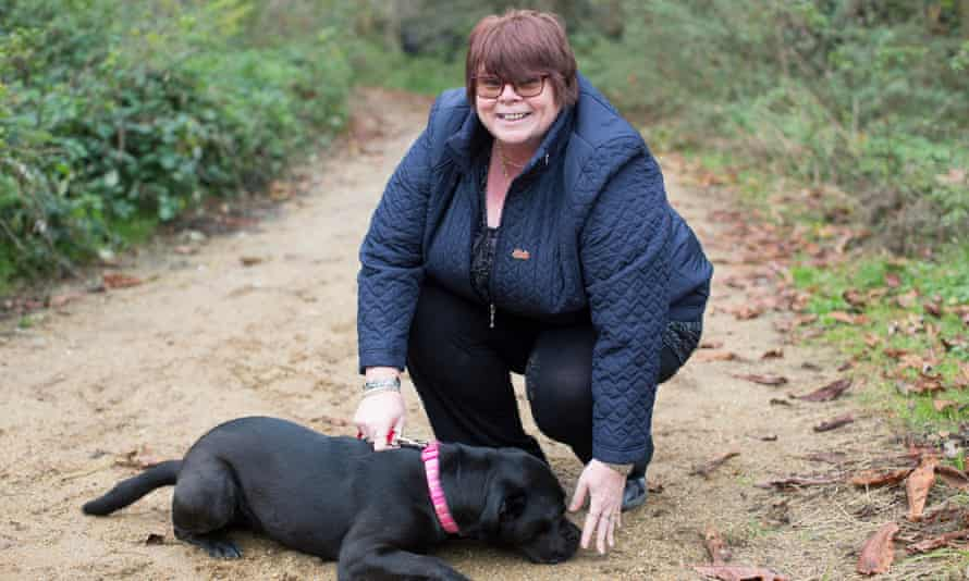 Sue with a dog like the ones she has fostered before.