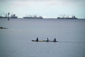 Outrigger canoe and net fishermen at Pohnpei in the western Pacific