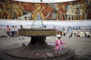 Ulaanbaatar, Mongolia A child walks around at the Zaisan Memorial in the Mongolian capital Ulaanbaatar