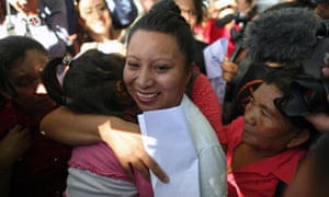 Teodora del Carmen Vásquez hugs her niece as she walks out of jail after her 30-year sentence was commuted.