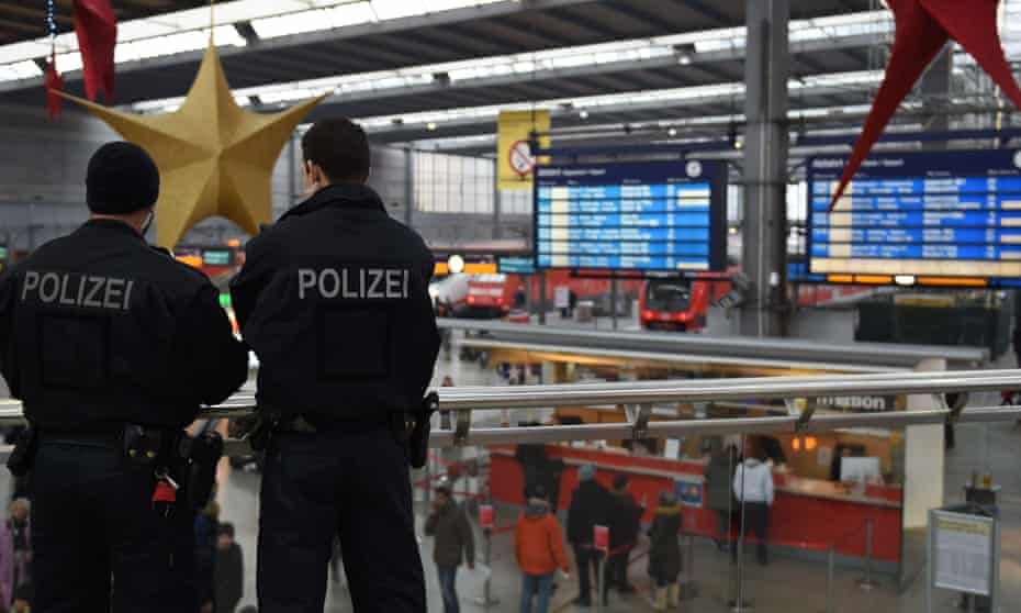 Police officers patrol at the main train station in Munich.