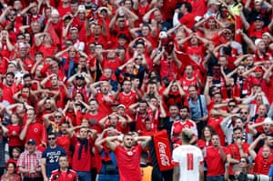 Armando Sadiku reacts with the Albanian fans after missing a chance.
