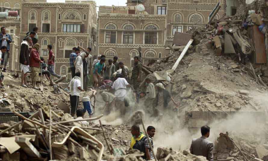 Yemenis searching for survivors under the rubble of houses in the capital Sanaa after a pre-dawn Saudi-led air strike.