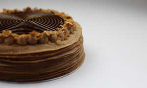 A chocolate mille crepe cake sold by Mille patisserie
