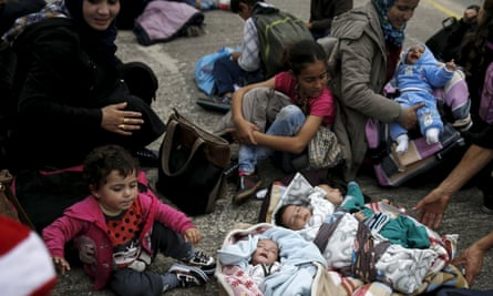 Syrian babies and children wait at the port of Piraeus, near Athens.