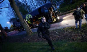 A police officer with the BVB team bus after the explosion on 11 April 2017.