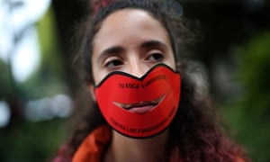 A woman demonstrates against Marcelo Crivella's censorship of an Avengers comic.