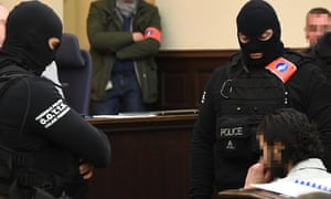 'In just a few sentences, Salah Abdeslam elevated himself from a deluded criminal to a potentially dangerous spokesman.' Abdeslam (right) on trial in Brussels in February.