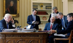 Donald Trump on the phone to Russia's president Vladimir Putin, with chief of staff Reince Priebus, vice president Mike Pence, senior adviser Steve Bannon, communications director Sean Spicer and national security adviser Michael Flynn. Oval Office, White House, Washington, January 2017. REUTERS