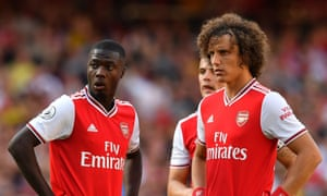 The arrival of Nicolas Pépé (left) completes a mouthwatering front three for Arsenal, but having David Luiz (right) at the back is creating a new set of problems.