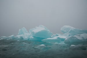 Mountains and floating ice in Svalbard.