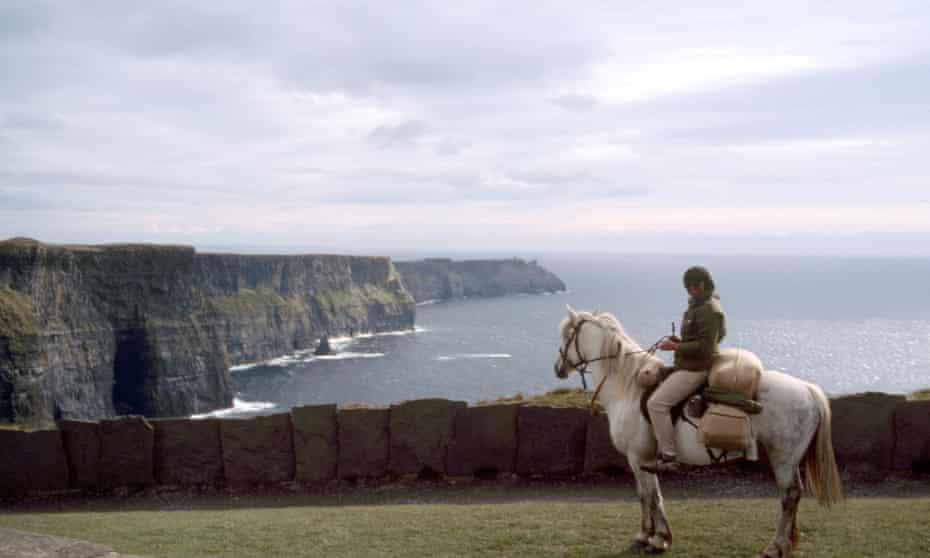 Hilary Bradt on her pony at the Cliffs of Moher, Ireland.
