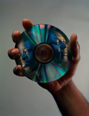 DJs Wayne and Bid's faces on a CD