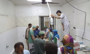 Surgeons work inside a Médecins Sans Frontières hospital after an air strike in the city of Kunduz, Afghanistan.