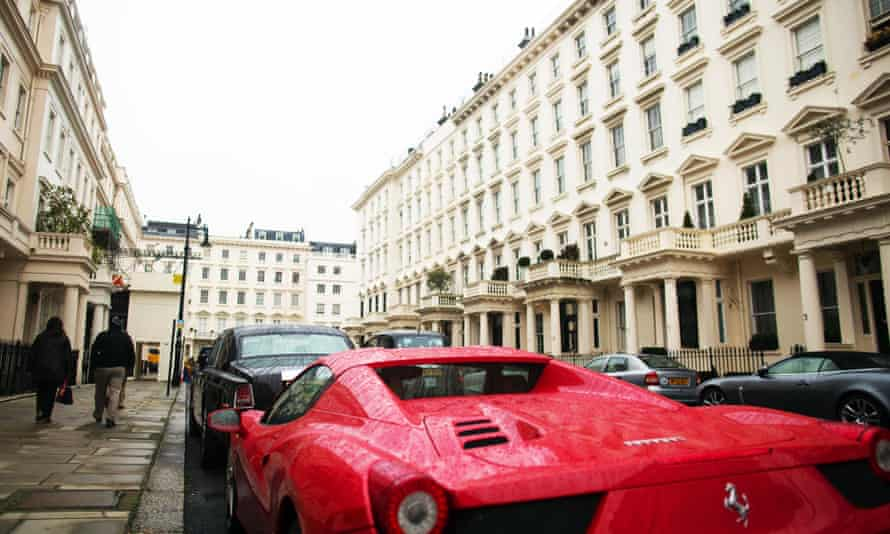 A Ferrari parked in a street in Kensington, where the average home costs £1.4m.