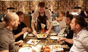 Diners served food at a restaurant in London