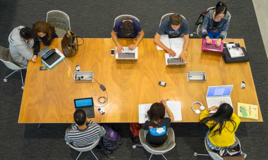 Students studying in the University of Melbourne's Baillieu Library