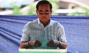 The Thai PM, Prayut Chan-ocha, casts his ballot at a polling station in Bangkok