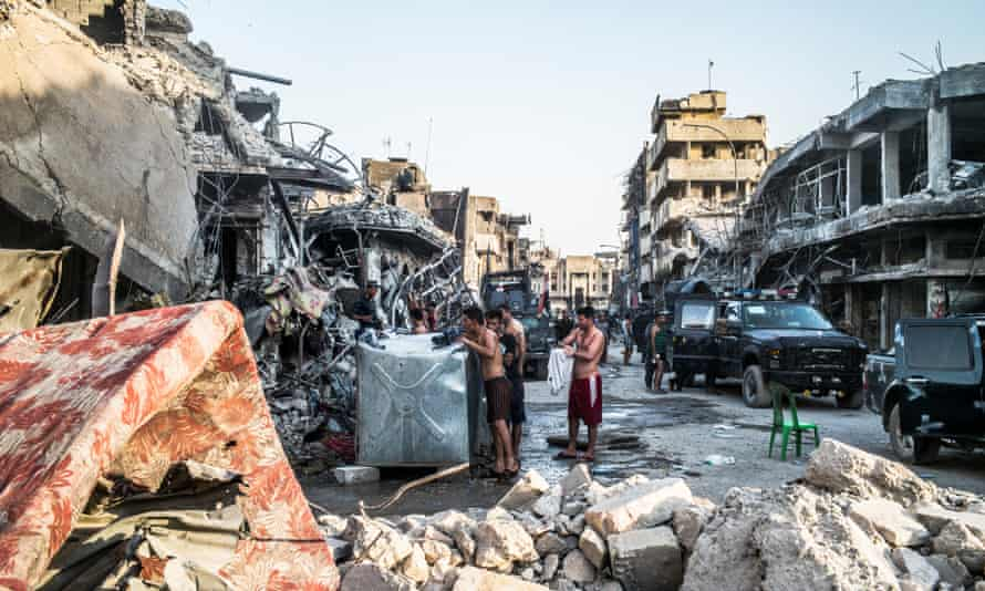 Iraqi soldiers and federal police resting and washing in the Old City of Mosul few days after the end of the fighting.