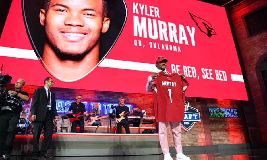 Kyler Murray poses with his Cardinals jersey after being picked as the No1 overall pick