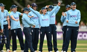 Danni Wyatt of England (c) celebrates with her team mates after catching Suzie Bates
