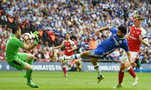 Arsenal goalkeeper David Ospina, right, saves a shot by Chelsea's Diego Costa.