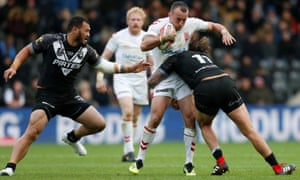 England's Josh Hodgson is held up by New Zealand's Kevin Proctor (right) and Leeson Ah Mau in the 18-16 win at Hull, where the crowd was around 6,000 down on the same fixture in 2015.