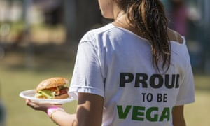 A woman with a vegan burger.