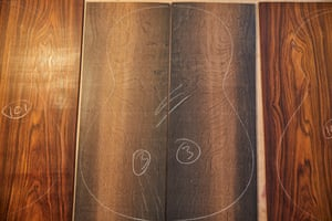 An outline of a guitar on wood