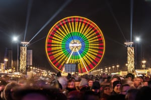 A ferris wheel lights up the night sky in Berlin
