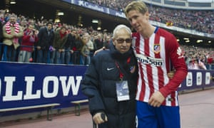 Atletico Madrid's Fernando Torres celebrates with Manuel Briñas, the man who discovered him as a 10-year-old.